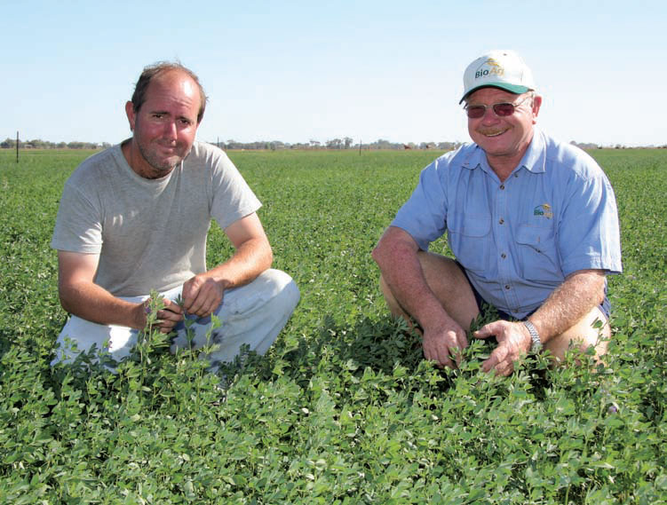 Farmer, Craig Sobey and BioAg agent, Ivan Mitchell, inspect a vibrant stand of irrigated lucerne at 'The Castle', Ballendella via Rochester, Victoria.