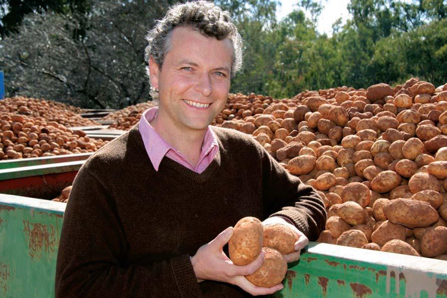 Jason Menegazzo holding a potato