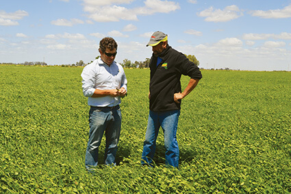 BioAg Area Manager Dan Hill with John Archard on John's dairy farm in Victoria.