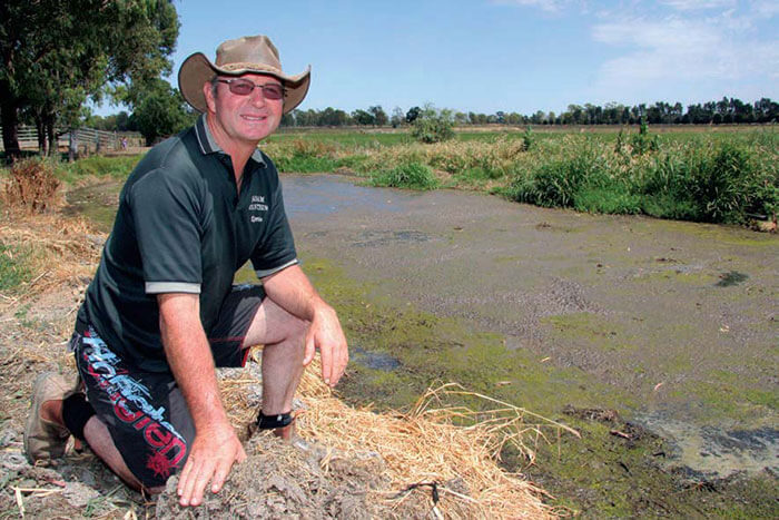 Kevin Fitzsimmons in front of his effluent pond