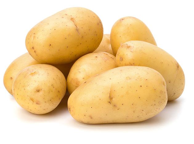 washed potatoes isolated on white