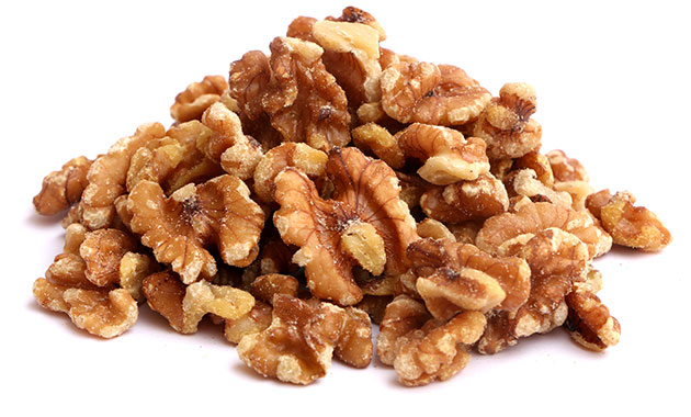 Several almonds lay on a flat surface